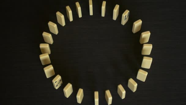 depositphotos_94306154-stock-video-slow-motion-circle-domino-effect